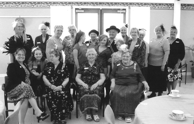 DAUGHTERS OF The American Revolution Celilo Chapter welcomed guests April 17 at the Adult Center in Hood River to honor Oregon State Regent Ellen Hopkins, who is pictured in a brimmed hat and sash in the back row.