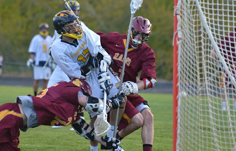 A smash by two Central Catholic defenders didn't stop Marcus Crouch  from scoring Tuesday in the Eagles 12-10 loss to the Rams.