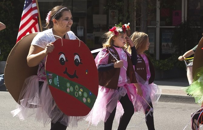 Members of the Girl Scouts march up Third Street during the 2013 Northwest Cherry Festival parade Saturday April 27.
