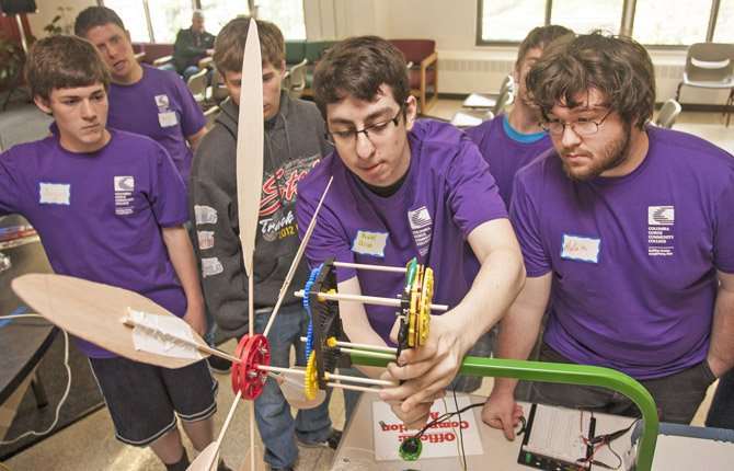Daniel, a junior from Lyle High School, and his team fine tune their wind turbine for the mechanical power test during the high School Wind Challenge at Columbia Gorge Community College April 20. The competition gives teams of high school students a chance to test their technology and science skills by building and presenting an effective wind turbine.	Contributed Photo/