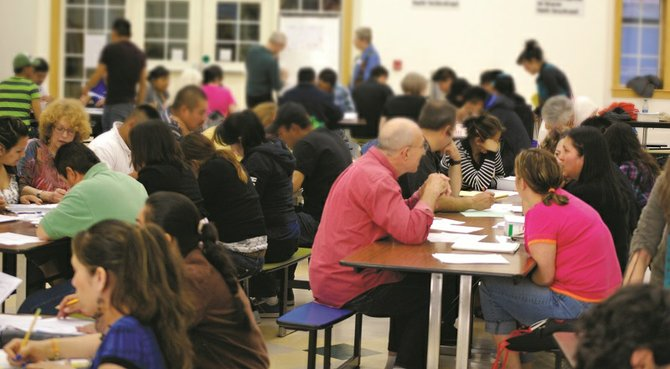 A rush of students and volunteer teachers fill the HRMS cafeteria, pursuing bilingual learning.