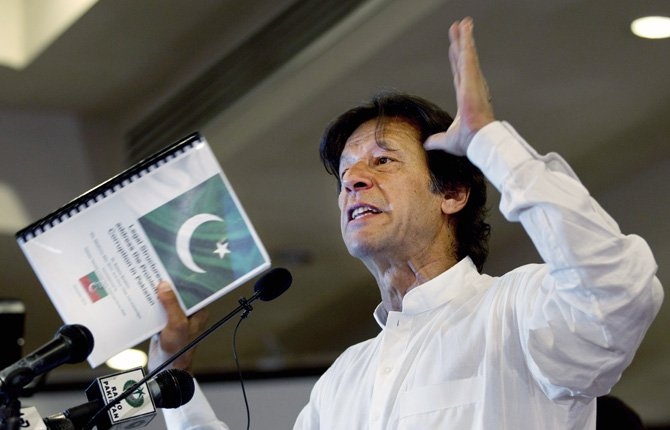 "Pakistan's former cricket star-turned-politician Imran Khan gestures as he speaks about his party, Pakistan Tehreek-e-Insaf in Islamabad, Pakistan in this April 9 file photo. Khan, who many analysts believe will end up playing a key role in the opposition after the election, has been even more critical of Pakistan's relationship with the U.S., saying he would ""end the system of American slavery."""