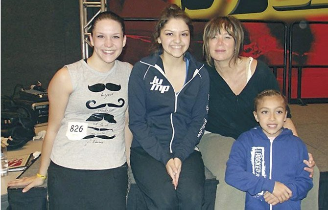 MEMBERS OF The Dalles Dance Team (pictured from left), Aubrey Hansen, Alejandra Pena and Meli Avila (far right) pose for a photo with instructor Mia Michaels while in Portland last weekend for the Jump Dance Convention.