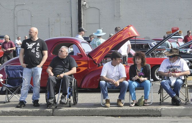 The KODL Classic Car Show attract spectators as others watch the parade.