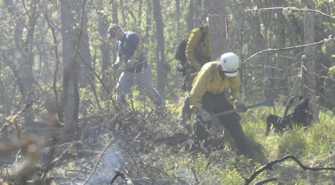 US Forest Service and Mid-Columbia Fire and Rescue firefighters work a fire line on Mountain View Drive on Sevenmile Hill in The Dalles. Kathy Ursprung photo