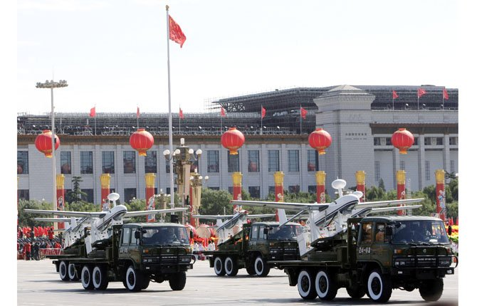TRUCKS LOADED with the Chinese made drones, the ASN-207, take part in a military parade marking China's 60th anniversary in 2009 held near Tiananmen Square in Beijing. Chinese aerospace firms have developed dozens of drones, known also as unmanned aerial vehicles, or UAVs, and analysts say that, although China still trails the U.S. and Israel, the industry leaders, its technology is maturing rapidly and on the cusp of widespread use for surveillance and combat strikes.