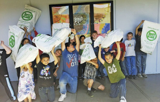 CHENOWITH ELEMENTARY School students hold up bags of trash they collected Thursday as part of Community Clean-up activities in The Dalles. See details on page A5 for the Saturday, May 4, main clean-up event.