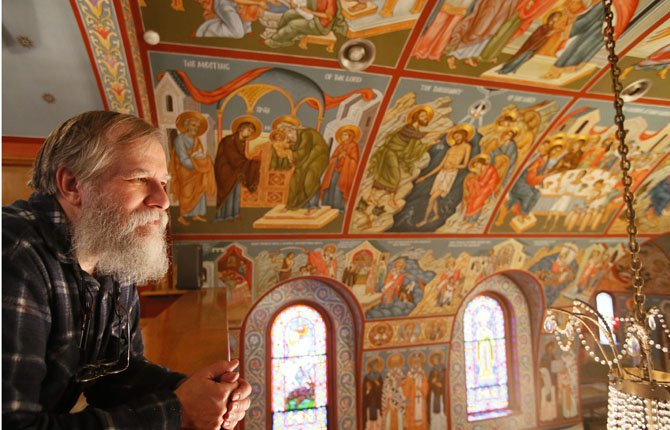 Iconographer Fr. Theodore Jurewicz looks over the icons he painted over the past six years, which totally cover the interior of the St. Stephen Serbian Orthodox Church in Lackawanna, N.Y., April 1 during a short break from painting.