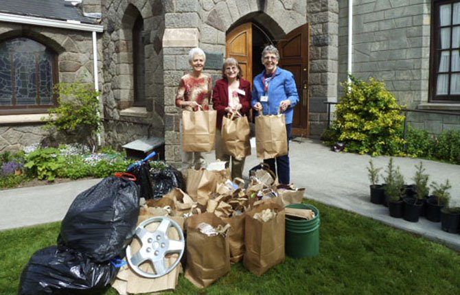 Pictured are UCC members Susan Stewart, Judy Dinnell, and Joy Krein in front of garbage collected during the denomination's environmental campaign.