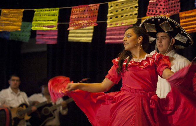 Dancer Daniela Leon performs onstage at The Dalles Wahtonka High School's MEChA Club presentation Friday, May 3, part of an early celebration of Cinco de Mayo. Marking the date of a famous Mexican battle that aided the North in the U.S. Civil War, the observance is often used to celebrate Mexican culture in the United States.