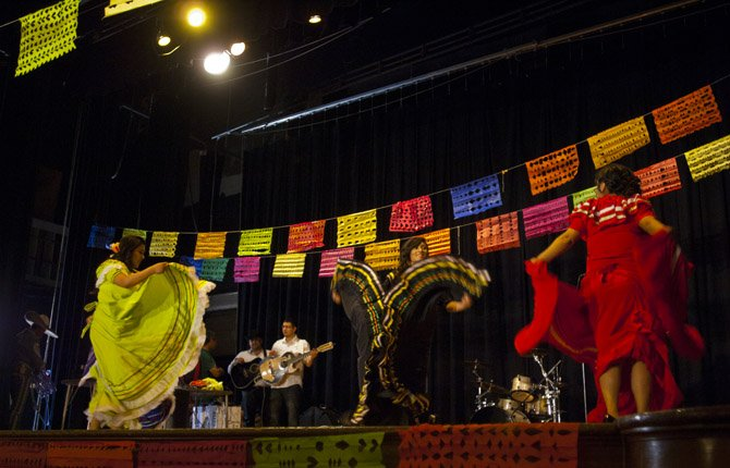 TRADITIONAL MEXICAN dancers, brought in by the MEChA Club, a group of American students born of Mexican parents, perform at The Dalles Wahtonka High School in early observation Friday, May 3, of Cinco de Mayo, the Fifth of May. Pictured onstage are, left to right, Janet Bustamante, Marta Gamez and Jackie Legorreta in the May 3 performance.