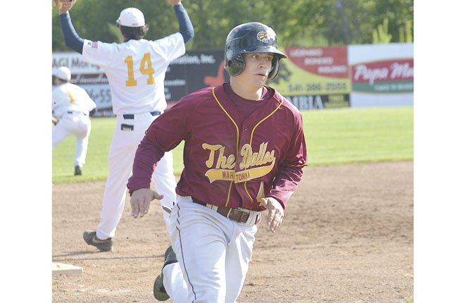 THE DALLES WAHTONKA'S Nolan McCall rounds third base in a game last week against Hood River. Friday in Hmersiton, the No. 4-ranked Tribe were held to four hits by Hermiston pitching in their 6-1 road loss.
