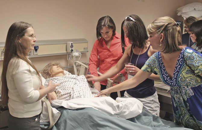 "Nursing Program students at Columbia Gorge Community College led tours around campus facilities for community members and student alumni during the 10th anniversary celebration of the program. Tour participants saw the CGCC Rural Clinical Simulation Center, which is designed to mimic clinical settings to provide the nursing students at CGCC the opportunity to practice nursing clinical judgment at the patient's bedside and to enhance their skills. The students are given clinically focused case scenarios in which they must act as the nurse and demonstrate safe, research-based nursing care as the ""patient's"" conditions change. Nursing faculty facilitate the students' learning experience in the simulation lab. The event also included comments from the college president, Dr. Frank Toda, and from CEO Ed Freysinger of Providence Hood River Memorial Hospital, who shared information about the partnership between the college and the hospital. This week is also Nurses Week in the United States."