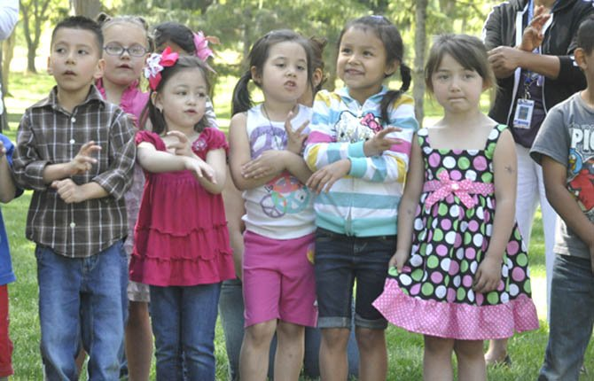 Head Start students seranade their parents with a set of songs during the annual Head Start barbeque May 3 to celebrate the students' and parents' accomplishments for the year. In math, for example, the students at The Dalles Head Start went from  29 percent meeting standards in the fall to 77 percent meeting or exceeding in the winter.  The barbeque is hosted by the Kiwanis Club, which also pays for books for students to take home throughout the year.