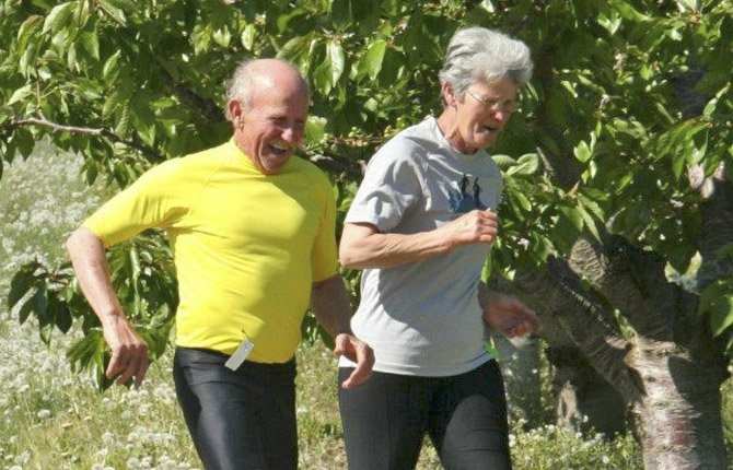 DRY HOLLOW participants (left to right), Bill and Kathy Mellow, of Hood River, strut it out during Saturday's 5k event in The Dalles. More than 75 harriers took part in the inaugural event.