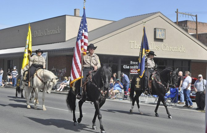 The Wasco County Sheriff 's Posse, shown above at the Northwest Cherry Festival in April, hosts an English and Western Trail Horse Challenge Saturday, June 8, at Fort Dalles Riders Club, 1023 Irvine Street in The Dalles. Competition starts at 9 a.m.