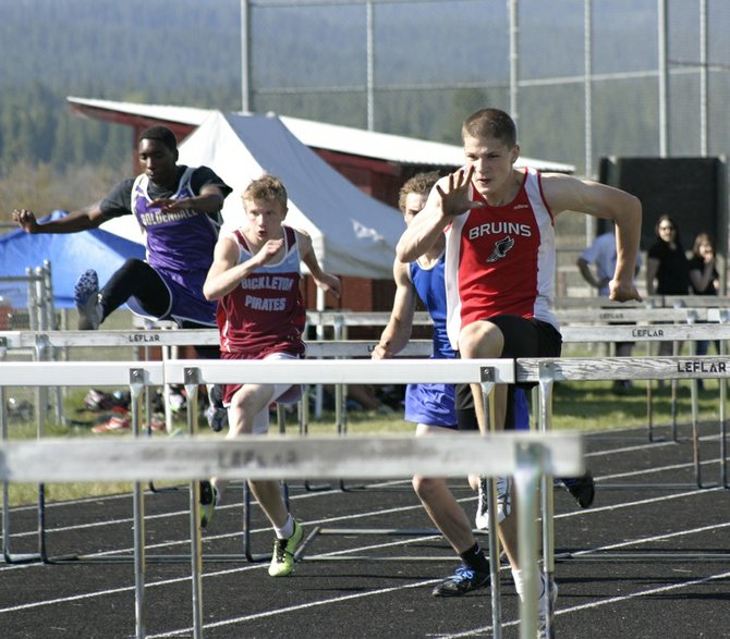 CHS junior Nathan Bell (right) runs to the lead during the boys 110-meter high hurdles final at last Friday's Jeff Agar Invitational Track and Field Meet in Glenwood. Bell won the race in a Columbia High School-record time of 15.07 seconds.
