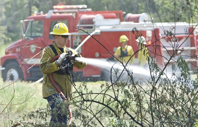 Flames escaped a burn pile along the Chenowith Airport on Chenowith Road, burning a small area of grass and brush.