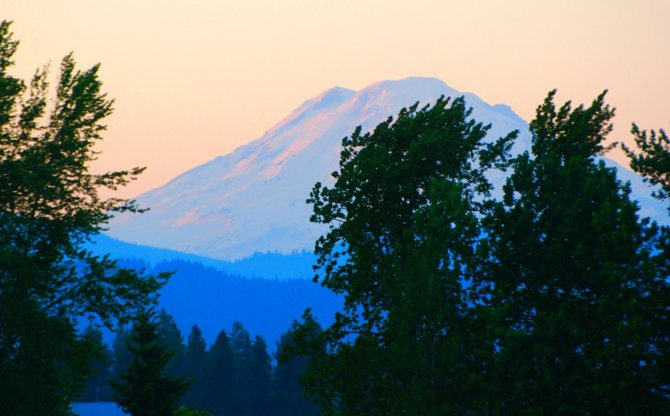 Expect a few more days of glorious sunsets like this one on Mt. Adams as seen from Barrett Drive near Alameda. High today of 88 is predicted with 82 on Saturday then expected rain on Sunday and a high of only 70. Monday temperatures will drop to 64 with continued predicted rain.