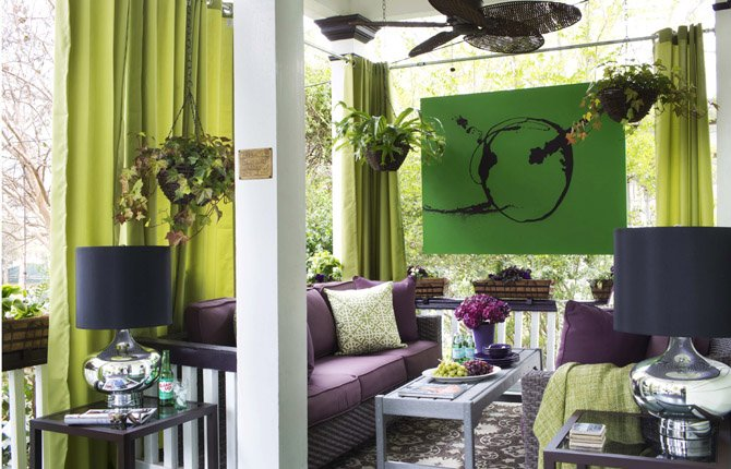 Drapery panels are added to this small outdoor porch by designer, Brian Patrick Flynn, to emphasize the ceiling, minimize its narrow dimensions and give the space privacy from neighbors. Flynn uses a few other tricks to make small outdoor spaces appear larger, which include hanging oversized art (painted on tent canvas with frames constructed of pressure-treated wood), and flanking seating areas with two love seats or sofas rather than chairs or loungers.