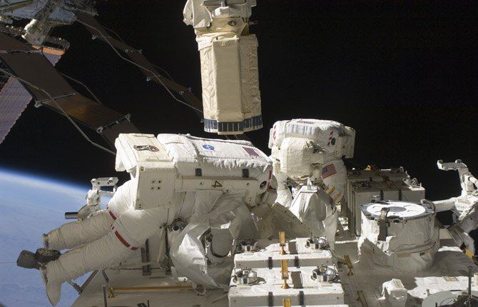 Astronauts Tom Marshburn, left, and Christopher Cassidy, shown in an earlier spacewalk for maintenance tasks. On May 11, the two astronauts made a hastily scheduled spacewalk to work on a leaking ammonia coolant line. The line chills power systems but power was rerouted and is operating normally. The six-member crew is not in danger.