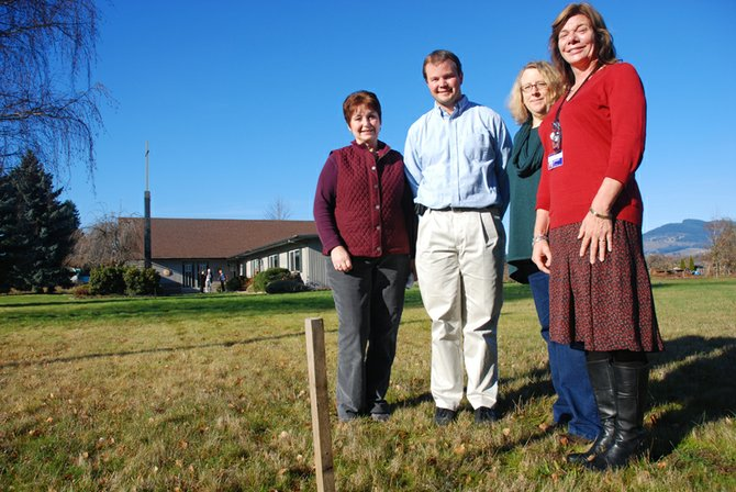 Food Bank building partners stand at corner stake for the FISH building at Our Redeemer Lutheran. From left are treasurer Becky Bugge, Lutheran Pastor Andrew Wendle, Debbie Chenowith and Marianne Durkan.