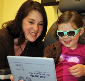 Dr. Rebecca Chown gives an eye exam to a youngster.