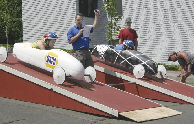"The Dalles Wahtonka and Dufur soapbox derby racers wait for the ""go"" signal from moderator Dave Karlson of Google in the Gorge Gravity Games, held Saturday, May 11, along Court Street."