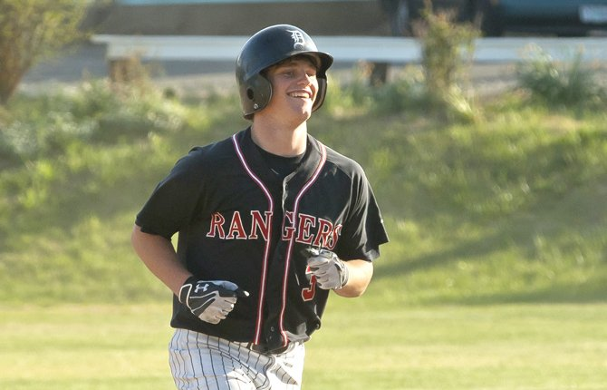 Dufur baserunner Cole Parke smiles as he rounds the bases following a game ending home run during Tuesday's May 14 district game against Pilot Rock.