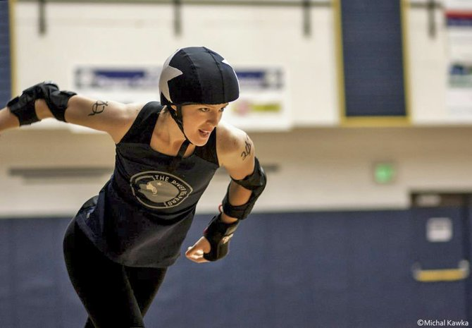 RIVER REAPER athlete Anya Kafka eyes her foes while skating up the floor in a run during Saturday's Gorge Roller Derby bout at Hood River Valley High School. The Dalles' Cherry Bombers came ahead with a 114-101 win.