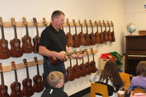 Music specialist Larry Wyatt  teaches up to six classes a day. Students use ukuleles, xylophones, hand drums and other instruments to learn music basics.