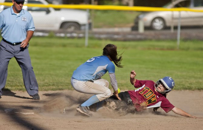 The Dalles Wahtonka courtesy runner Ruthie Ford sldes into second as Corvalis junior Daphne Dupray loses control of a throw. Ford was safe, early in Friday's play-in district game in The Dalles May 17.