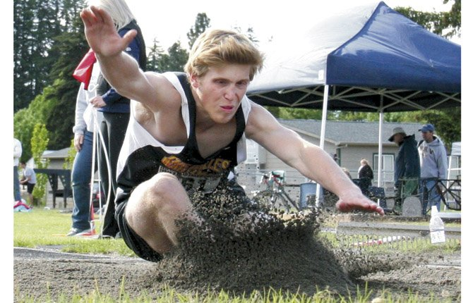 TDW athlete Harris Farr hits the dirt on his long jump attempt in Friday's 5A state track and field meet at Henderson Field in Hood River. Farr set a new combined school record of 22-feet-5 inches to grab a district crown and a state berth.
