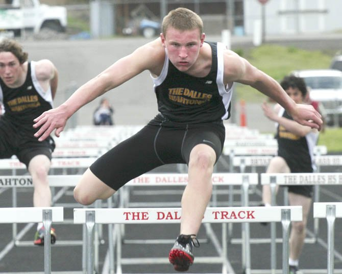 TDW track athlete Zach Nerdin is in action at a recent track meet in The Dalles. Nerdin had a time of 16.15 seconds to place second in the 110-meter hurdles at this weekend's 5A district meet in Hood River. 	  		 Scott McMullen/Contributed photo