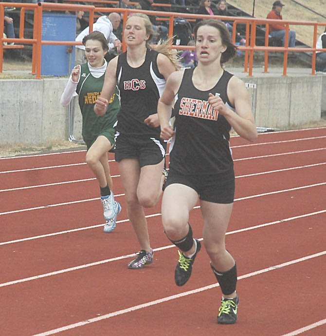 Sherman's Andie Harrison burst through the final 30-feet on her way to first-place in Saturday's 1A Big Sky district track and field meet in Moro. Harrison had a final time of one minute and 6.28 seconds to secure top honors.  Mark B. Gibson photo