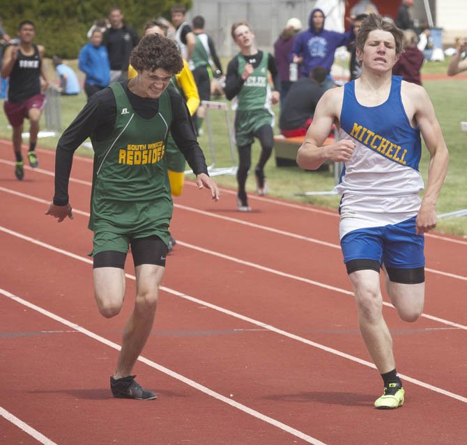 South Wasco County athlete Loreto Morelli (left) fights toe-to-toe with Mitchell's Brett Domenighini down the stretch in their 400-meter district track and field championship race Saturday at Sherman High School in Moro. Morelli crossed the tape in 53.65 seconds to finsih in second place and earn a trip to Eugene for the state event at Hayward Field.