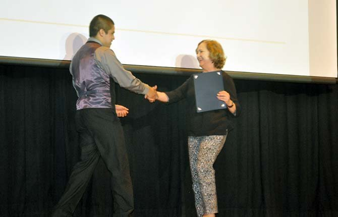 Luis Gaeta, left, recieves an award from math teacher Linda Skov, right, during The Dalles Wahtonka High School's first Evening of Excellence.