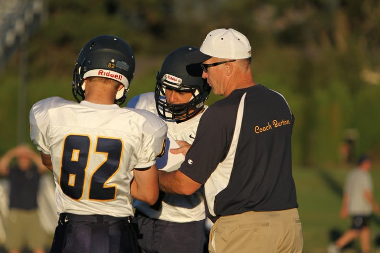 Bruce Burton is seen in action as HRV football's offensive coordinator. The longtime coach will be honored in Eugene Saturday at the Oregon Athletic Coaches Association's annual awards banquet.