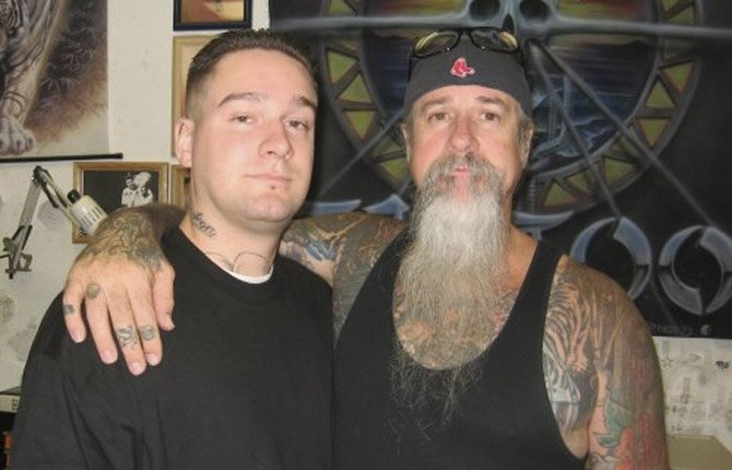 JACOB HANKS, left, and his father Larry Hanks are both award-winning tattoo artists. Jacob's The Dalles business draws clients from all over the world.
