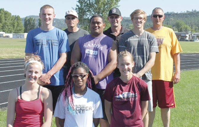 THE DALLES WAHTONKA track athletes take some time out from state meet preparations for a team picture with event coaches Tuesday in The Dalles. They are (front row, from left to right), Maya Barnard-Davidson, Yasmin Hill and Katie Conklin. In the middle row are Zach Nerdin, Lio Tunai and Harris Farr. The coaches in the back row are (from left to right), Bill Caddy (hurdles), Dave Cornell (shot) and Jim Taylor (jumps).