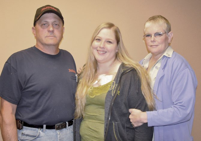 Letitia Robarge, center, has an opportunity to go to the Mayo Clinic for treatment of her POTS disease. Her parents Vicki and Michael Bennett are shown with her.