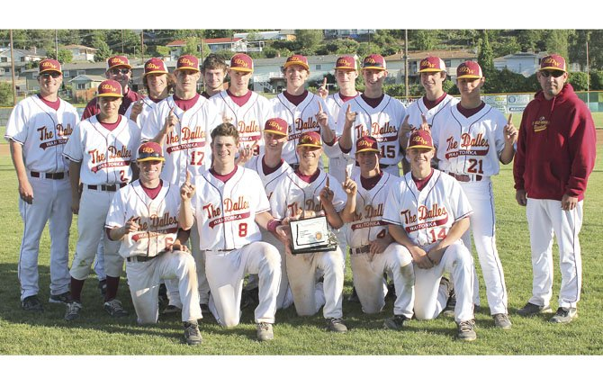 THE DALLES WAHTONKA baseball team gathers around for a group picture with their 2013 Columbia River Conference league championship trophy. TDW finished with a 9-3 league record.