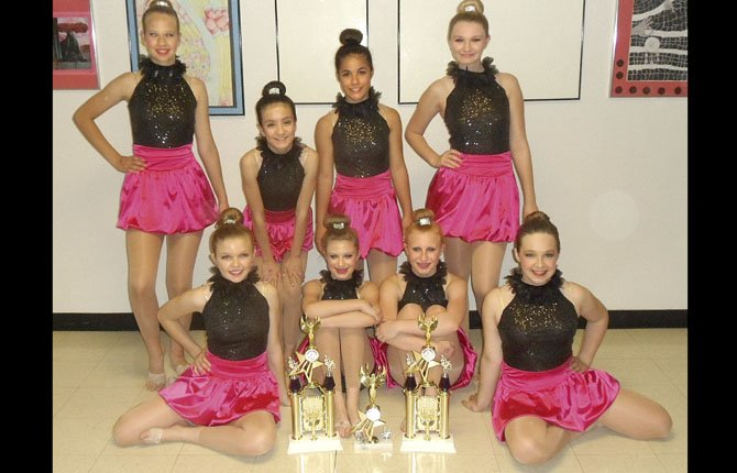 THE DALLES DANCE team members from the advanced group in tap and jazz proudly display their trophies after competition this past weekend in Portland. They are (pictured from left to right, back row), Abby Mains, Jessika Nanez, Brianna Gamez and Autumn Ringer. In the front row are (pictured from left to right) Tianna Smith, Hannah Wallis, Abbey Helseth and Ally Lutgens. This group had the highest score in their classification at the Portland Dance Academy Event.