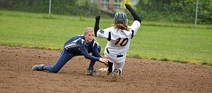 Amanda McCafferty of HRV tags out a Bend baserunner in a 8-2 HRV win in the first round of the 2013 OSAA 5A state playoffs.