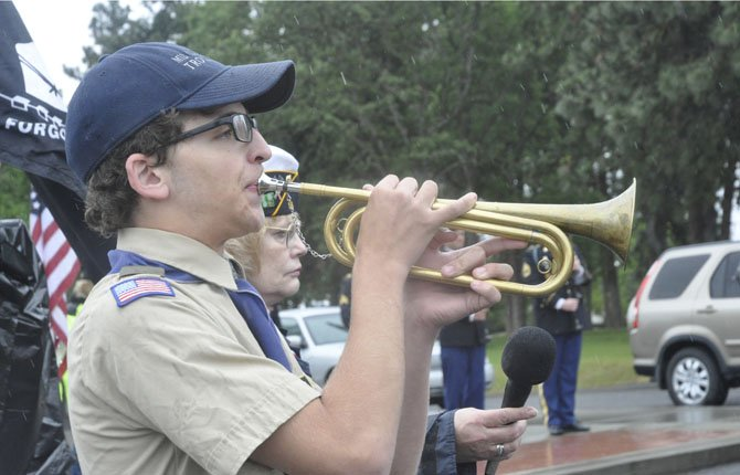 Josiah Chrisman plays Taps to end the annual Memorial Day observance at Kelly Viewpoint Memorial in The Dalles, one of two events organized by American Legion Post 19 and Auxiliary, in partnership with Veterans of Foreign War Post 2471 and Auxiliary.