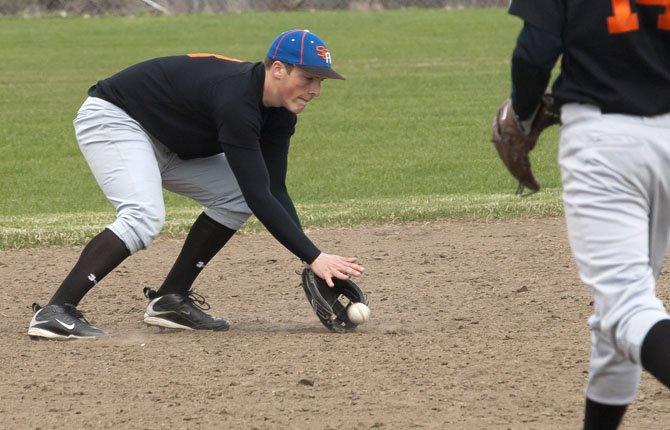 SHERMAN'S Riley Brown gobbles up a groundball hit his way during practice this season in Moro. Brown and teammate Nick Coleman were the only two players to pick up all-league recognition for the Huskies.