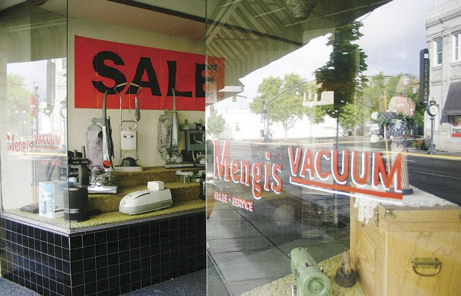 MENGIS VACUUM Sales and Service is moving out of its longtime storefront location at 305 E. Second St., but will continue to service vacuums and sewing machines for their regional customers.