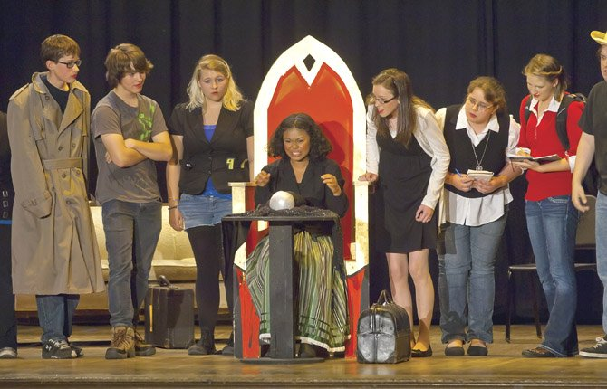 """GYPSYROSE (Madeleine Morgan) gets an unclear reading from her crystal ball as she looks for clues to """"The Mysterious Case of The Missing Ring"""" during a Night of One Acts presented by The Dalles Wahtonka High School drama department Wednesday, May 29."""