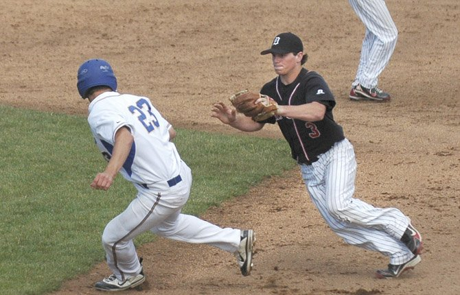 DUFUR RANGER junior Cole Parke (right) runs down a Stanfield runner in this season's Blue Mountain Conference championship game in The Dalles. Parke had a .511 average with three home runs, a team-leading 44 runs scored, 15 stolen bases and 35 RBIs to chalk up a spot as a first team all-state infielder.