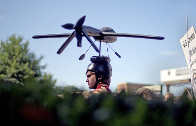 Adan Wadley, of Dunwoody, Ga., wears a drone hat as he protests against the use of drones outside the International Conference on Unmanned Aircraft Systems at the Grand Hyatt Hotel May 28 in Atlanta.